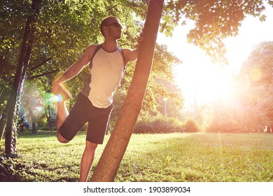Sporty young adult man training in the park.
