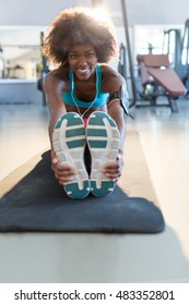 Sporty young African American woman working out