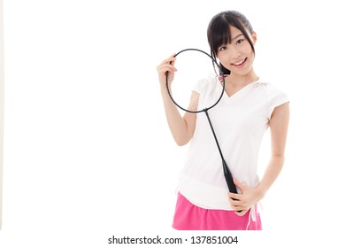 a sporty young asian woman with racket on white background