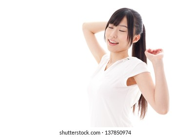 a sporty young asian woman relaxing on white background