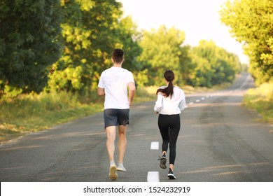 Sporty young couple running outdoors
