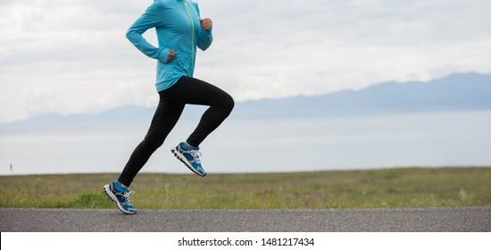 Sporty young fitness woman ultramarathon runner running on road