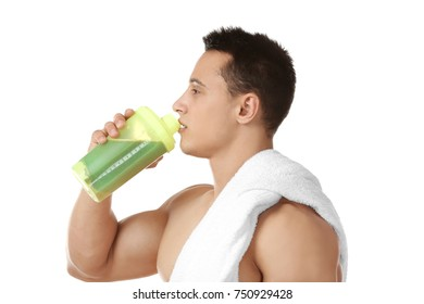 Sporty young man drinking protein shake on white background
