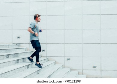 Sporty Young Man Running Downstairs Outdoors