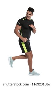 Sporty young man running on white background