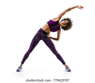 Sporty young woman doing  fitness exercise abs isolated on white background. Concept of healthy life. Full length