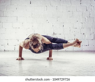 Sporty young woman doing yoga practice isolated on white background - concept of healthy life and natural balance between body and mental development.
