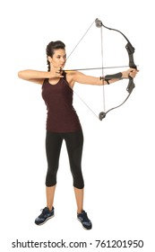 Sporty young woman practicing archery on white background