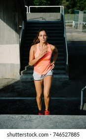 Sporty young woman running and exercising.