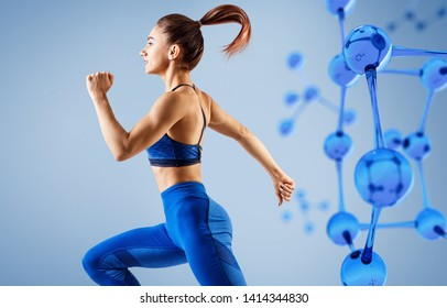 Sporty young woman running and jumping near molecules structure. Metabolism concept.