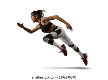 Sporty young woman running on isolated on white background