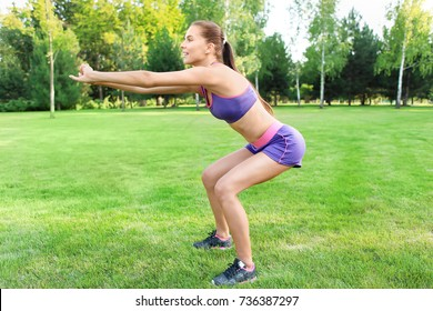 Sporty young woman training in park