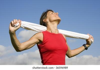 Sporty young women with towel enjoying the sun