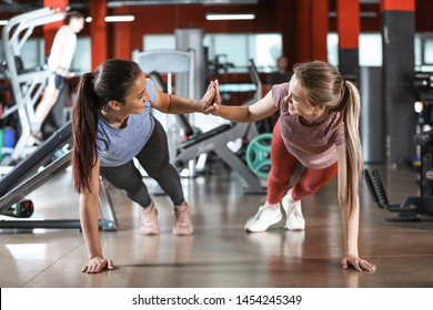 Sporty young women training in gym