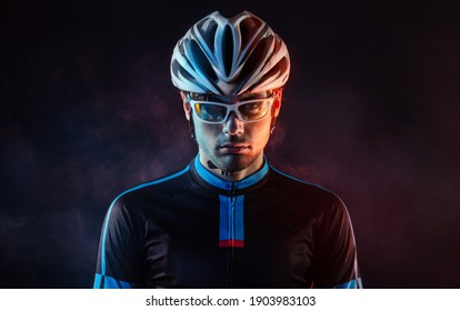 Spost background with copyspace. Cyclist. Dramatic colorful close-up portrait.