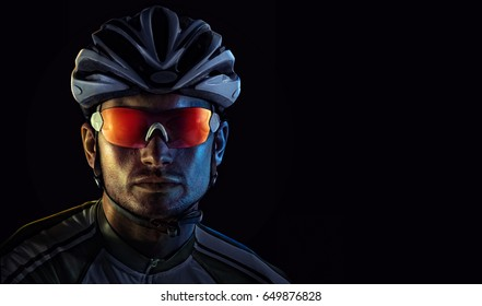 Spost background with copyspace. Cyclist. Dramaticcolorful close-up portrait.