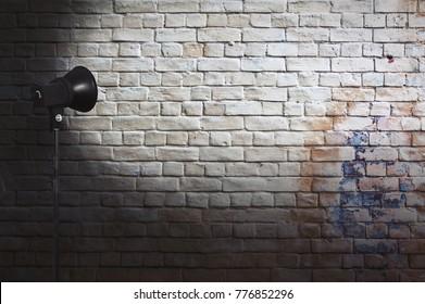 spot light on brick wall