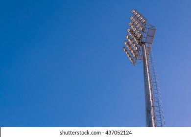 Spot lights in stadium.blue stadium football field in Daytime .soccer.football euro