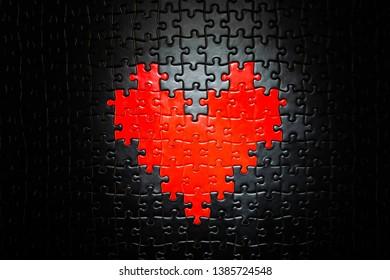 Spot lit heart shape puzzle pieces
