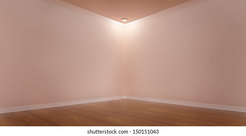 Spotlight in a Corner of a Pink Room With Vases