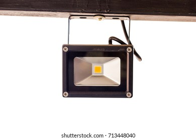 spotlight hanging at steel bar. isolated on white background.