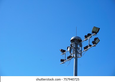 The spotlight are mounted on metal poles high twilight atmosphere.