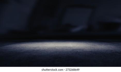 Spotlight on concrete floor.