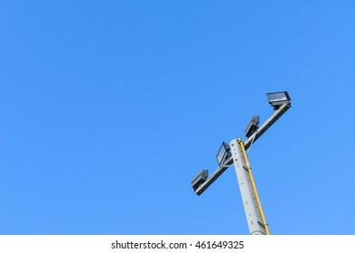 Spotlight pole with blue sky background