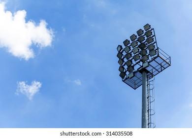 Spotlight pole over clear blue sky