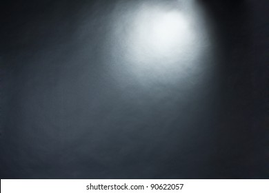 Spotlight studio interior, black background