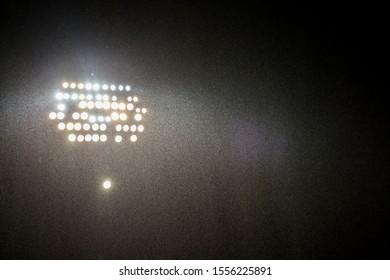 spotlights in the stadium by dark with rain