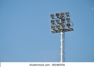 Spotlights in the stadium on a bright day for suitable for outdoor competition.