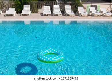Spotted blue inflatable ring in swimming pool