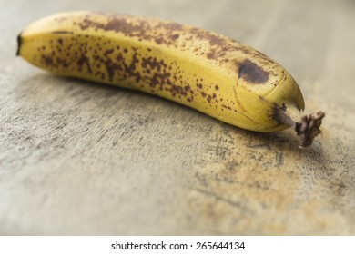 Spotted brown banana ready for baking banana bread