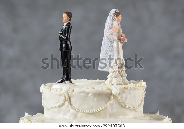Spouses having their first disagreement Wedding cake spouses turning their backs to each other for emerging problems