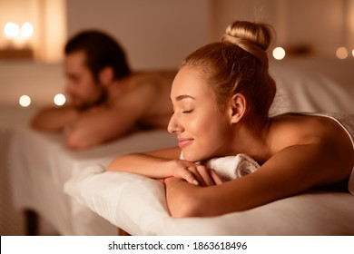 Spouses Resting After Relaxing Massage Therapy Lying With Eyes Closed In Luxury Spa Resort. Aromatherapy, Beauty, Wellness And Relaxation Treatment Concept. Low Light, Selective Focus