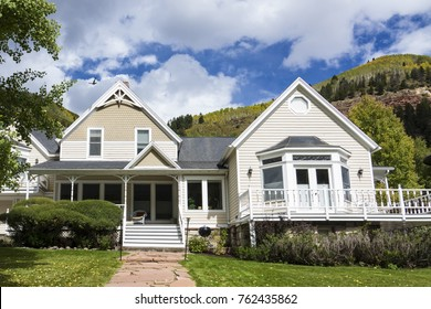 Sprawling clapboard house in Telluride, Colorado, with mountains in the background