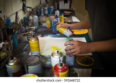 Spray art painter in his workshop