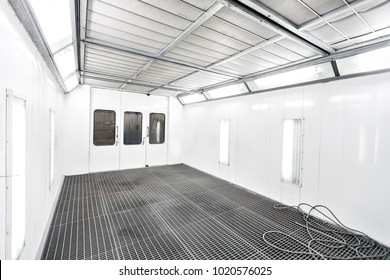 Spray paint cabinet in a car repair station. Auto service concept. High-quality painting of vehicles in a room with a filter and good light