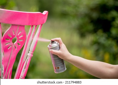Spray paint an old chair pink