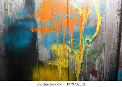 spray paint patterns on a wooden wall
