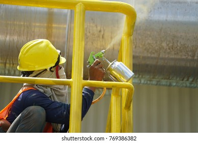 Spray painting Yellow color to the steel by the worker
