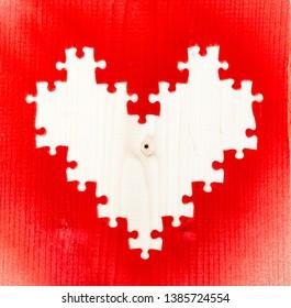 Sprayed heart shape puzzle pieces