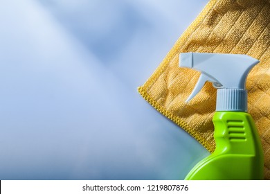 Sprayer cleaning washcloth on white background.