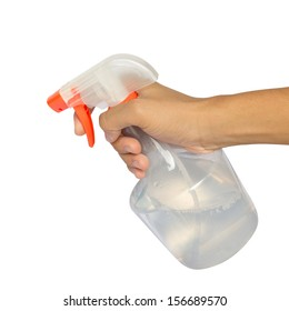 Spraying a cloth with laundry detergent in spray bottle.