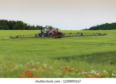 Spraying crops before harvesting, Jutland, Denmark