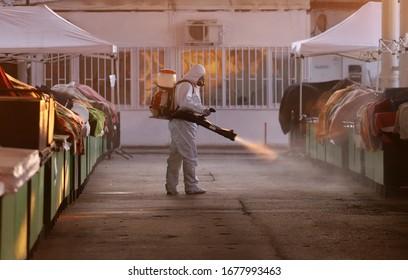Spraying, disinfection and decontamination on a public place as a prevention against Coronavirus disease 2019, COVID-19. Coronavirus quarantine.