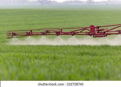 Spraying machine working on the green field