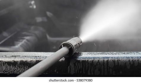 spraying pressure washer for car wash