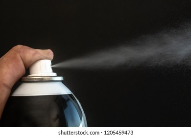 Spraying a thin mist with a black background. Using a spray